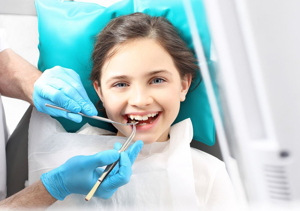 child at the dentist dental sealants middleborough ma